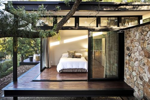 Pavilion architecture with floating stone wall